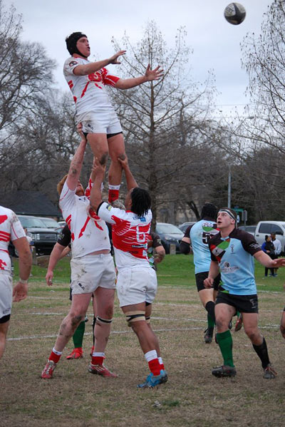 Chad Joseph is lifted by his teammates in a lineout