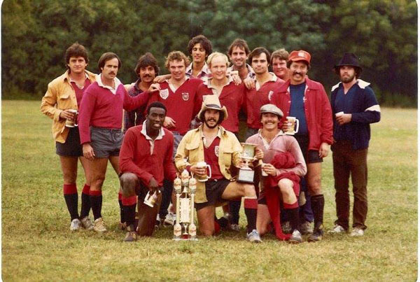 Dallas Rugby 1970s team posing after winning Championship
